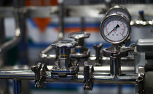 View Of Analog Meter ,steel Pipes And Industrial Process Equipment Background
