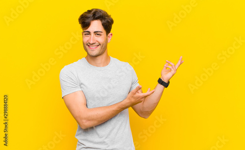 Fotomural  smiling proudly and confidently, feeling happy and satisfied and showing a conc