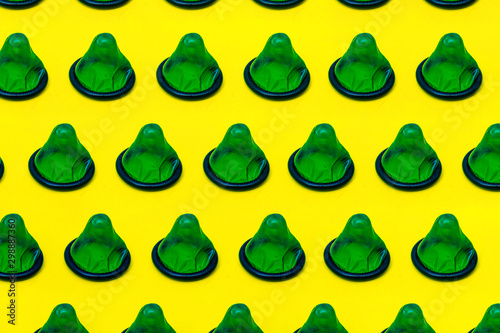 Cuadros en Lienzo many condoms isolated on the yellow background,collection, composition of condom