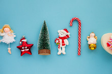 Christmas Composition. Beautiful Toys, Gifts And Candy On The Blue Background. New Year Background. Top View. Close Up. Space For A Text.