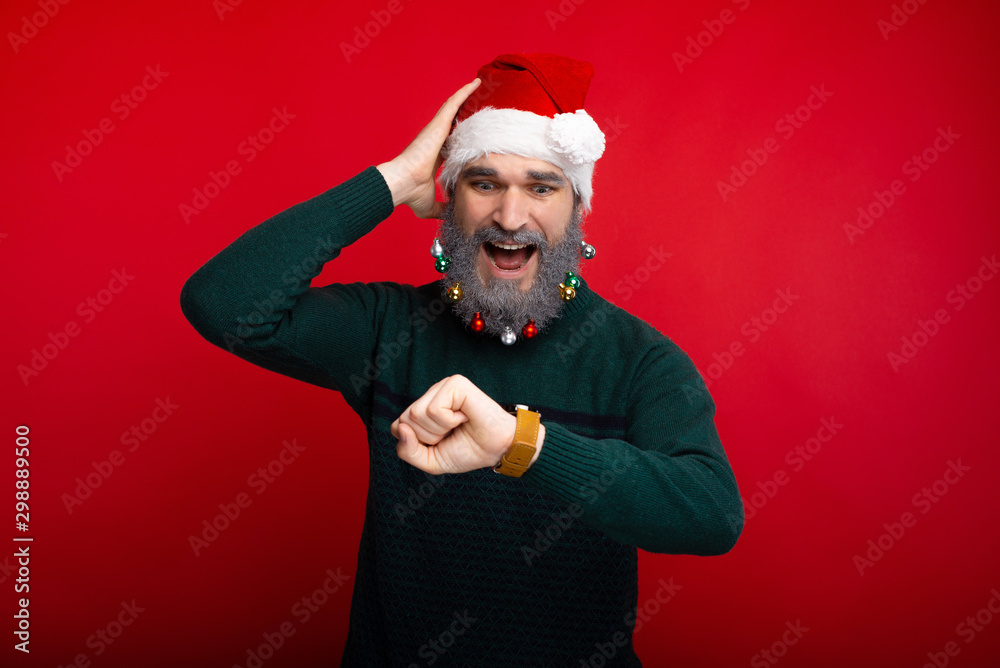 Fototapety, obrazy: Photo of man with white decorated beard looking confused at watch