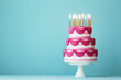 canvas print picture - Tiered birthday cake with golden candles