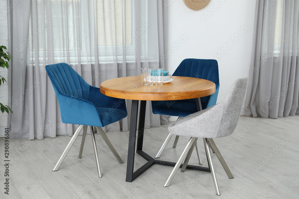 Fototapety, obrazy: Stylish room interior with dining table and chairs