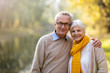 canvas print picture - Happy senior couple in autumn park