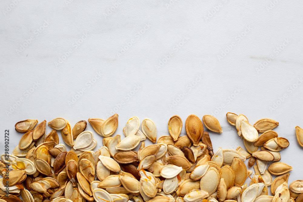 Fototapety, obrazy: roast Pumpkin seeds background, flat lay