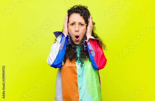 young pretty woman looking unpleasantly shocked, scared or worried, mouth wide o Fototapet