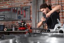 Man In Home Workshop Garage Wo...