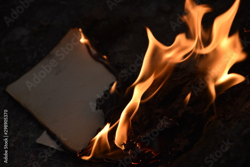 Canvastavla  book burning fire flame page