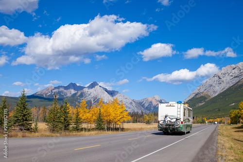 Leinwand Poster An RV aon the highway through the Canadian Rocky Mountains in Kananaskis, Albert