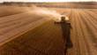 Leinwanddruck Bild - Farmer harvesting soybeans in Midwest