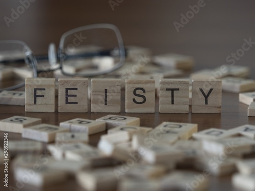 Valokuva  The concept of Feisty represented by wooden letter tiles