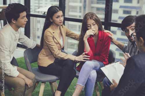 Group problematic young people talking with a guidance counselor. Fototapete