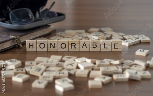 Fototapeta  The concept of Honorable represented by wooden letter tiles