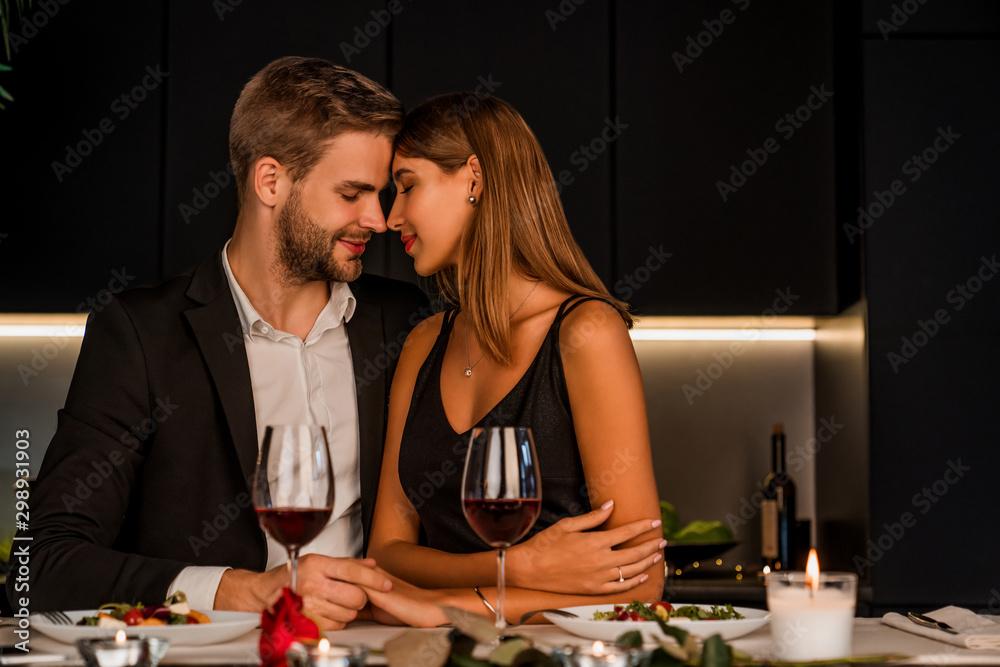 Fototapeta Sweet couple having romantic dinner at home
