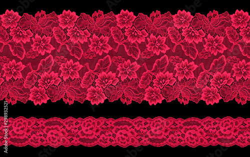 Set of red lace ribbons on a black background. Lace braid. Wallpaper Mural
