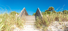 Wooden Stairs Over Sand Dune A...