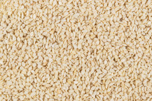 Raw White Sesame Seed Background. Top View. Food Background. A Scattering Of Sesame Seeds. Healthy Food. Natural Food.