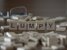 The Concept Of Lumpy Represented By Wooden Letter Tiles