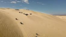 Multiple Buggies Driving Down Glamis Sand Dunes In California, Aerial