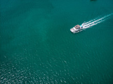 Bird Eye View Of The White Motor Boat Moving Fast, The Vessel Leaves A Beautiful White Trace Behind; Boating Concept.
