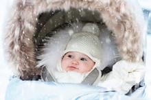Baby In Stroller In Winter Snow. Kid In Pram.