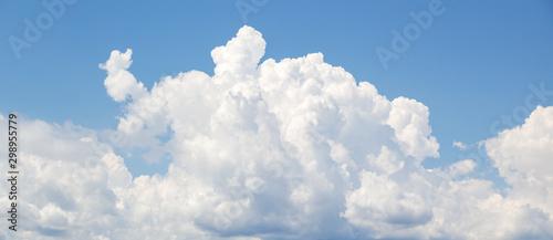 Obraz White cumulus clouds formation in blue sky - fototapety do salonu