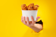 Hand Giving Chicken Nuggets