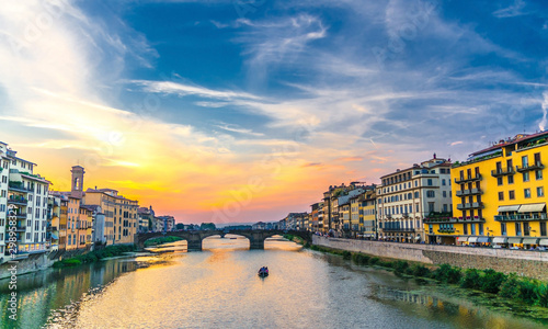 St Trinity Bridge stone bridge and boat on Arno River water and embankment prome Canvas Print