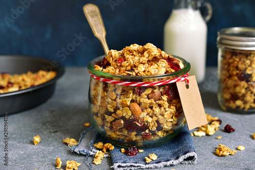 Valokuvatapetti Homemade multicereal granola with nuts and dry fruits  in a vintage jar