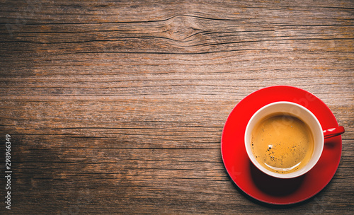Fotobehang koffiebar Cup of aromatic black coffee on a wooden background.