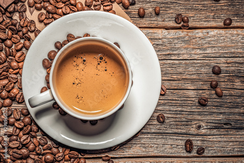 Keuken foto achterwand Cafe Cup of aromatic black coffee on a wooden background.