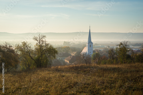 Photo sur Toile Europe de l Est Church in a village in Transylvania, Romania on a misty autumn morning