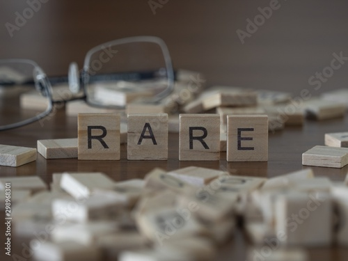 Photo The concept of Rare represented by wooden letter tiles
