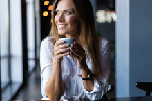 Woman Drinking Coffee In The M...
