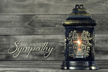 Sympathy Card With Grave Lantern On Wood Background
