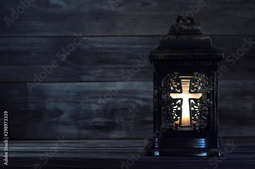 Canvastavla  All Saints Day. Votive candle on dark background with copy space