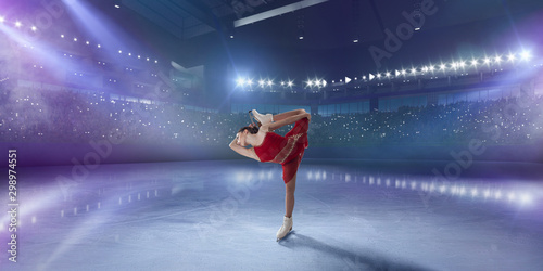 Figure skating girl in ice arena.