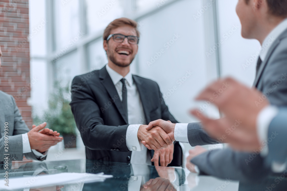 Fototapety, obrazy: smiling businessman shaking hands with his business partner