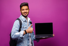 Pretty Idian Man With Computer...