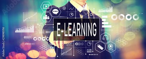 E-learning concept with a businessman on a shiny background Obraz na płótnie