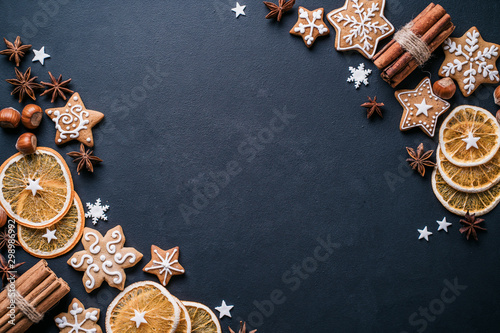Christmas and New Year composition. Festive decorations and homemade gingerbread with copy space for text design. Holiday and celebration concept, greeting card or invitation mockup
