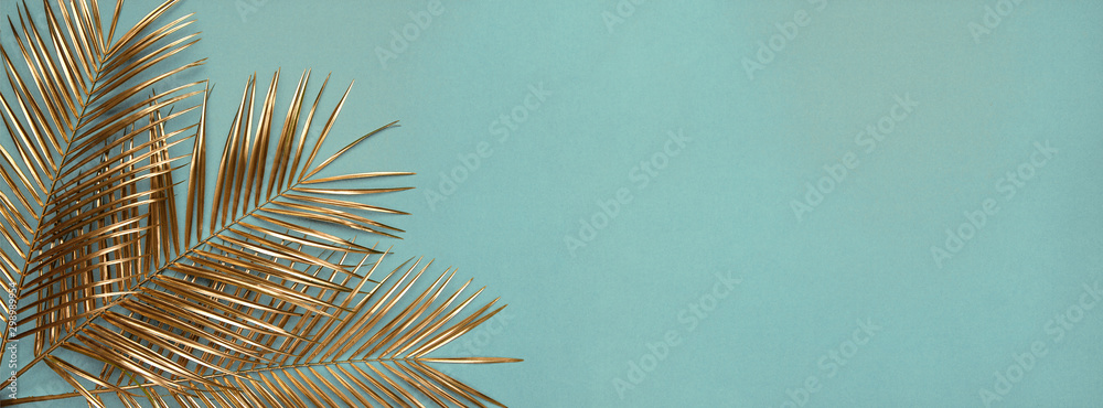 Fototapety, obrazy: Three gold painted date palm leaves on desaturated turquoise background