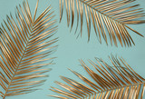 Gold painted date palm leaves on desaturated turquoise background