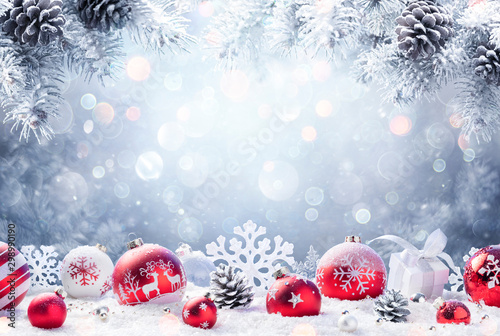 Poster Countryside Christmas - Red Ornament On Snow With Fir Branches