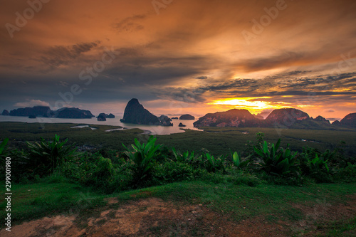 Staande foto Zandwoestijn Panoramic nature background (mountains, sea, trees, twilight lights in the sky, waterfront communities), naturally blurred through the wind, seen on tourist spots or scenic spots