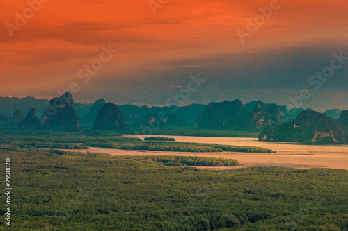 Fotobehang Baksteen Panoramic nature background (mountains, sea, trees, twilight lights in the sky, waterfront communities), naturally blurred through the wind, seen on tourist spots or scenic spots