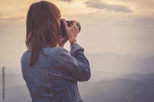 Obraz Young woman photographer taking photo view in Nan, Thailand. Travel concept. - fototapety do salonu