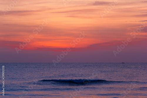 landscape view the beautiful silhouette last little bit of the sunrise light shoots of the sea