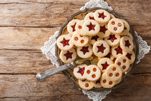 Christmas Shortbread Linzer Cookies With Jam Filling Close-up On The Table. Horizontal Top View