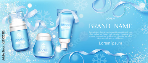 Fototapeta Winter cosmetic tubes and cream jar on blue background with snowflakes and ribbons. Cold season moisturizing beauty cosmetics product bottles set mock up line. Realistic 3d vector illustration, banner obraz